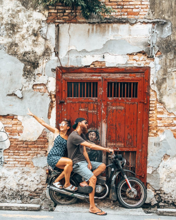 wediditourway sitting on a motorcycle in Penang