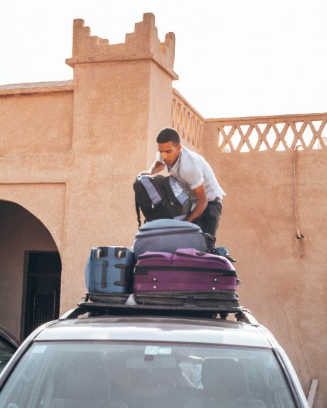 Ismail packing up our jeep for the trip out of the desert