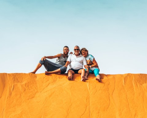 On top of the sand dune in the Sahara Desert with my parents