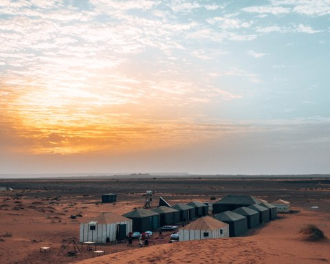 Watch the sunrise of the Sahara desert at the Luxury Sahara Camp