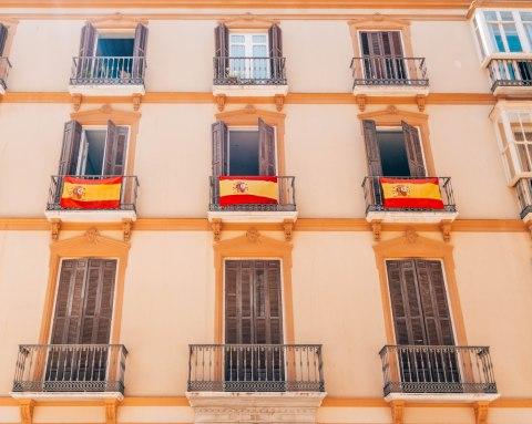 spanish flags balconies malaga spain