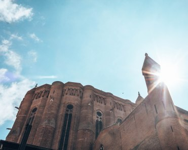 Cathedral Basilica of Saint Cecilia outside sun flare 2 Gers France