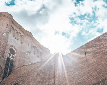 Cathedral Basilica of Saint Cecilia outside sunflare Gers France
