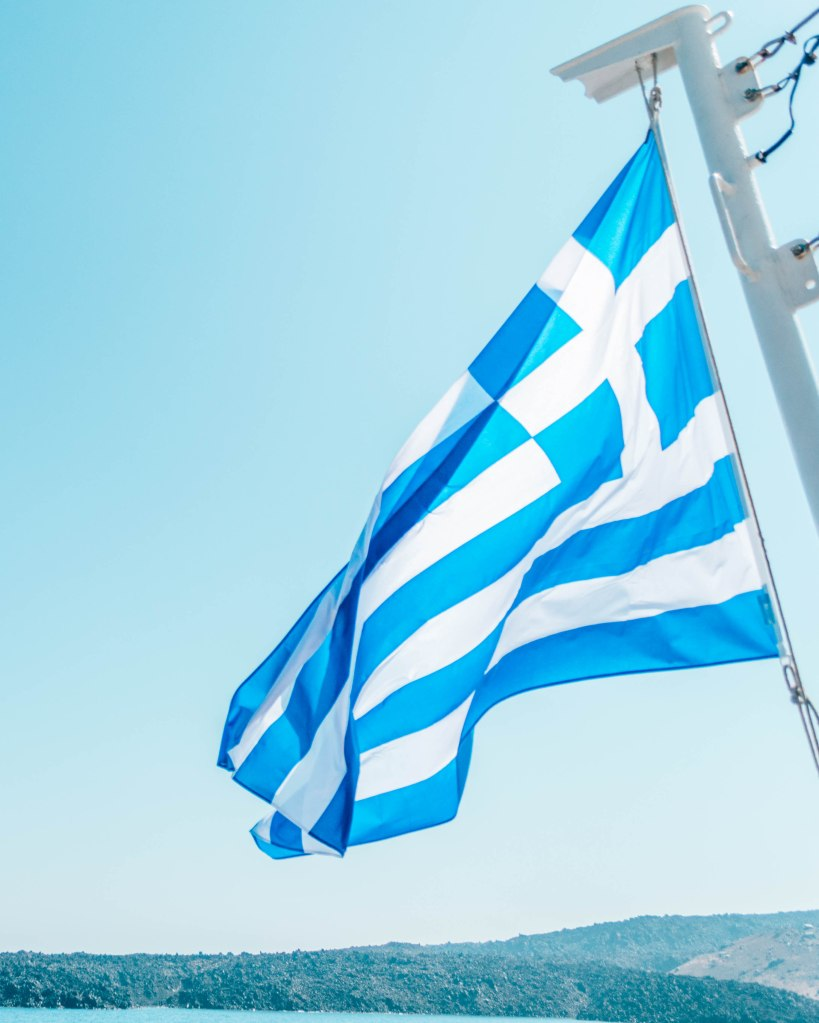 Greek flag from the ferry Santorini Greece