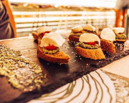 Mozarella di buffalo tomato and pesto brushetta in Athens Greece