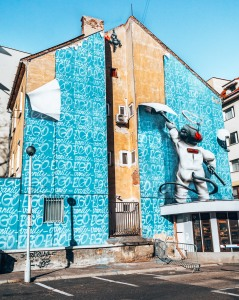 Street art of a baby wallpapering the building in Bratislava, Slovakia