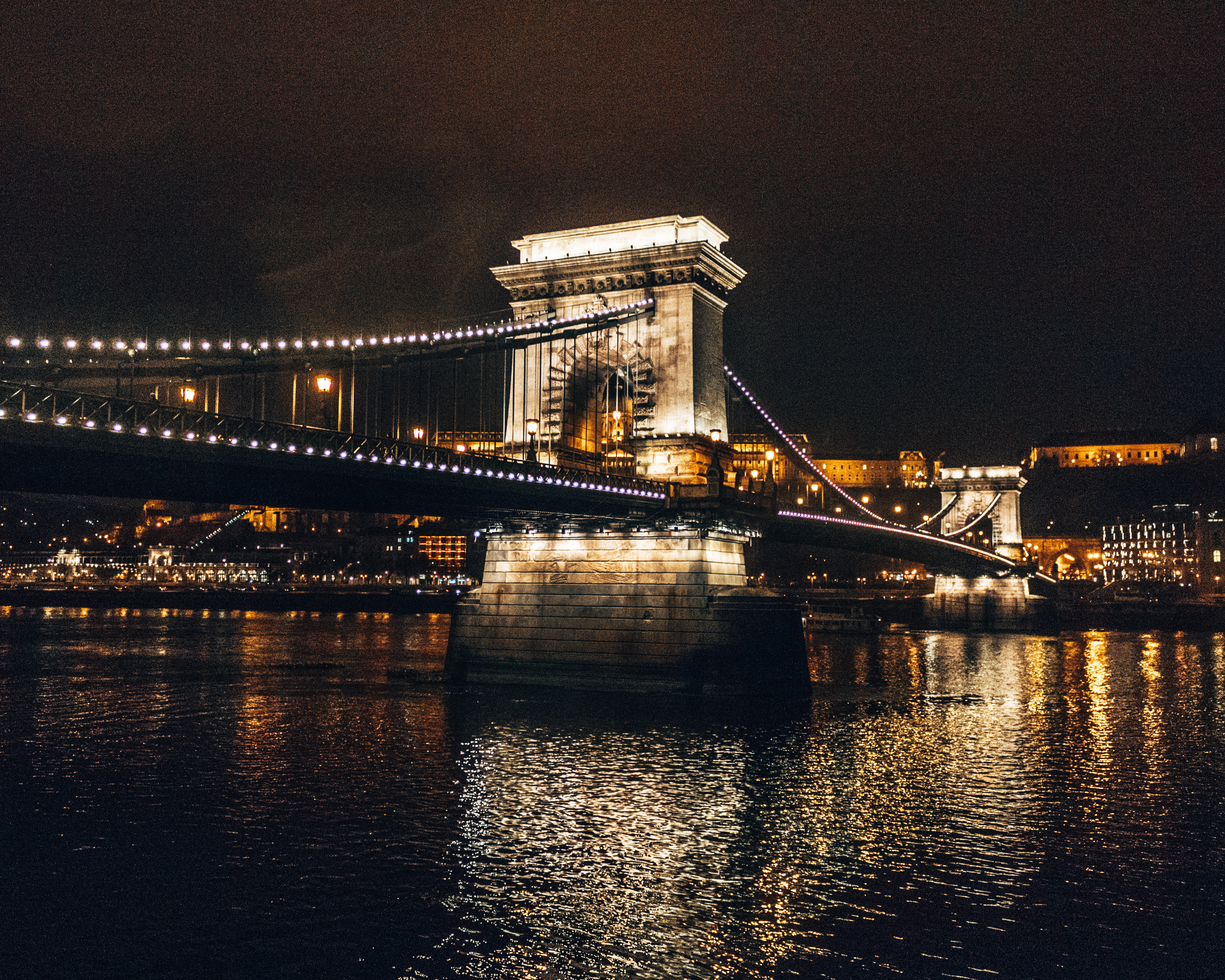 The famous Chain bridge lit up at night in Budapest, Hungary