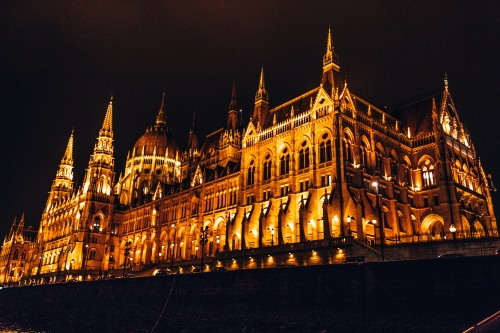 The Hungarian Parliament building all lit up at night in Budapest, Hungary