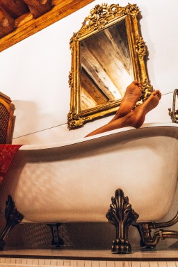 Carine taking a relaxing bath at Orlowska Townhouse in Krakow, Poland