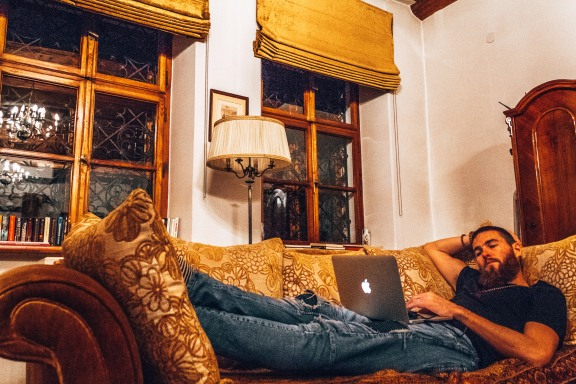 Derek chilling out and working on the couch at Orlowska Townhouse in Krakow, Poland