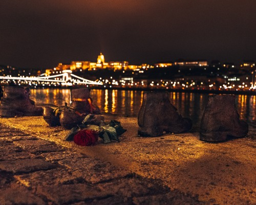 The famous Shoes on the Danube river at night in Budapest, Hungary