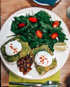 Vegetarian avocado toast and poached egg breakfast at Urban Bistro in Bratislava, Slovakia