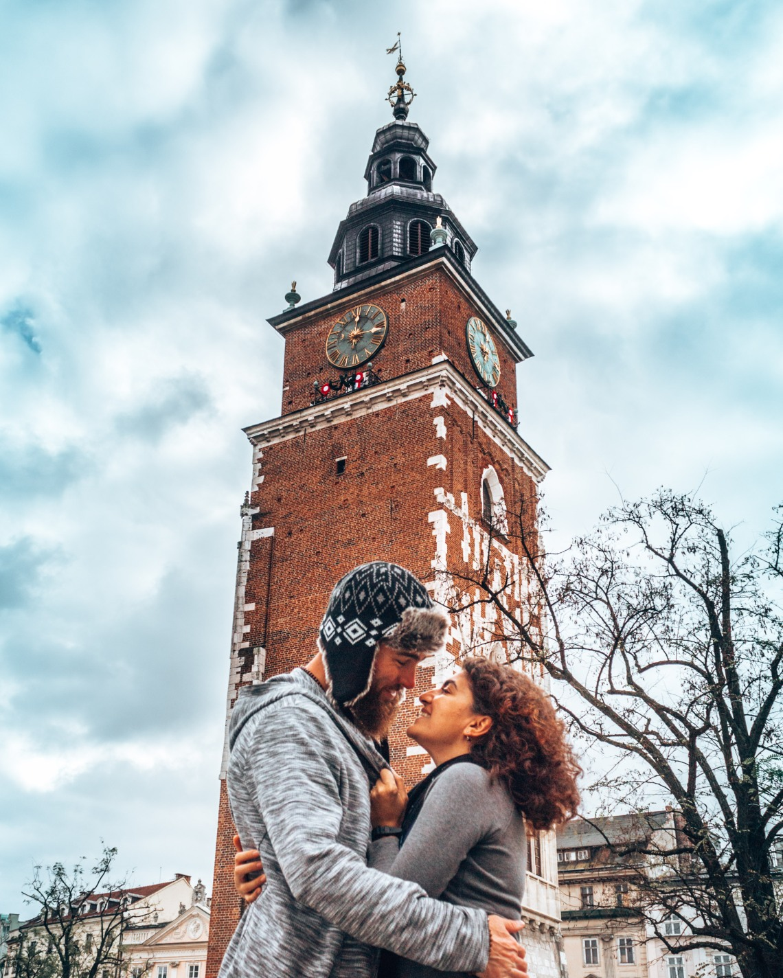 Wediditourway lovingly embracing in front of the Town Hall Tower in Krakow, Poland