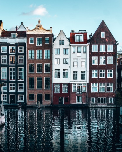 We love the reflections of the houses on the canals of Amsterdam, Netherlands