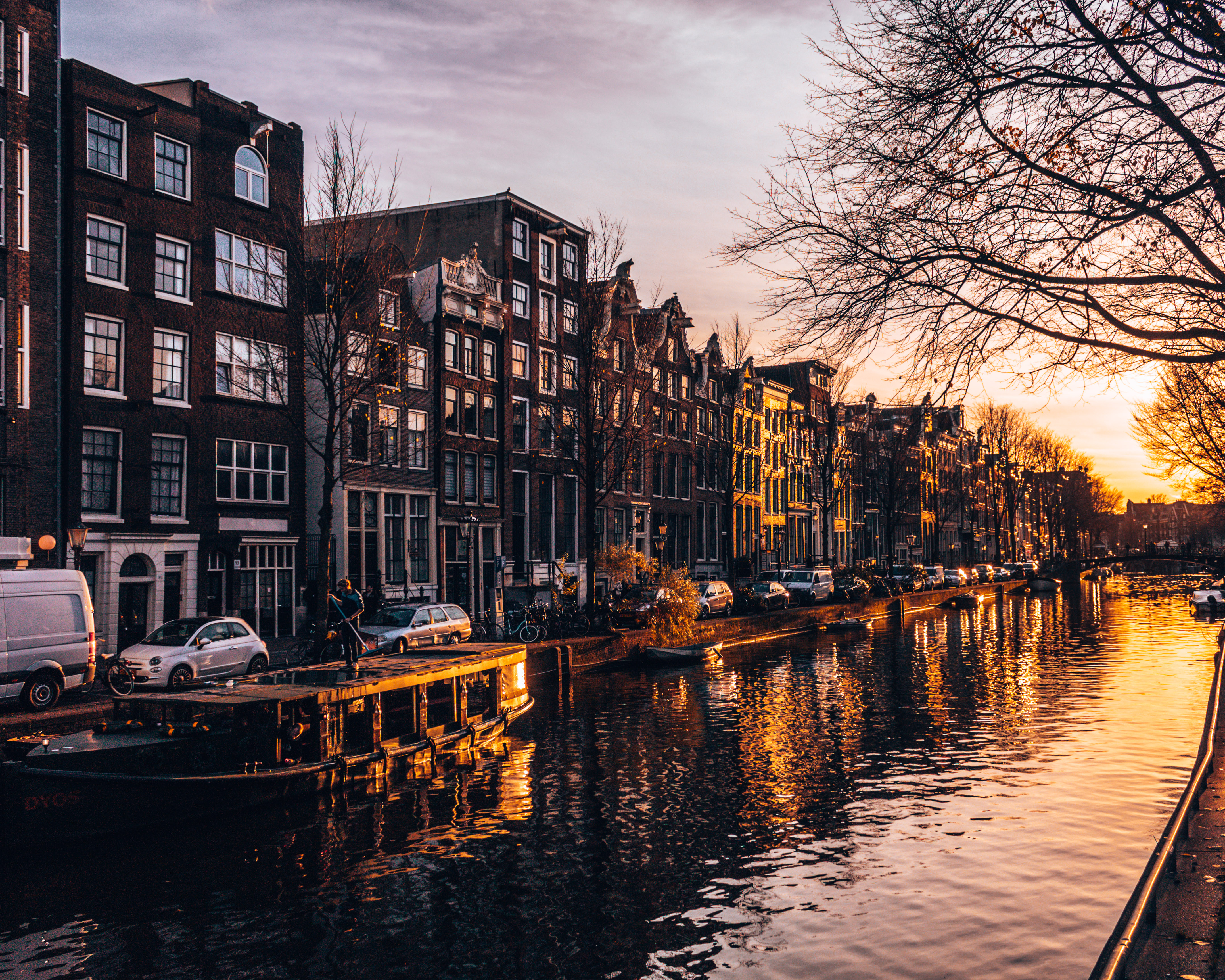 The sun sets over the canal in Amsterdam, Netherlands