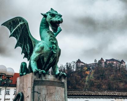 A dragon statue from the Dragon Bridge in front of the Ljubljana Castle, Slovenia