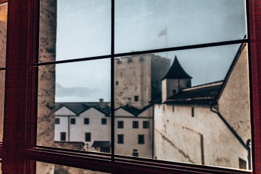 Looking out a window in the Hohensalzburg Fortress in Salzburg, Austria