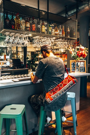 Grab a drink at the bar of the Stayokay Vondelpark hostel in Amsterdam, Netherlands