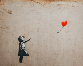 Girl with balloon by Banksy at the Moco Museum in Amsterdam, Netherlands