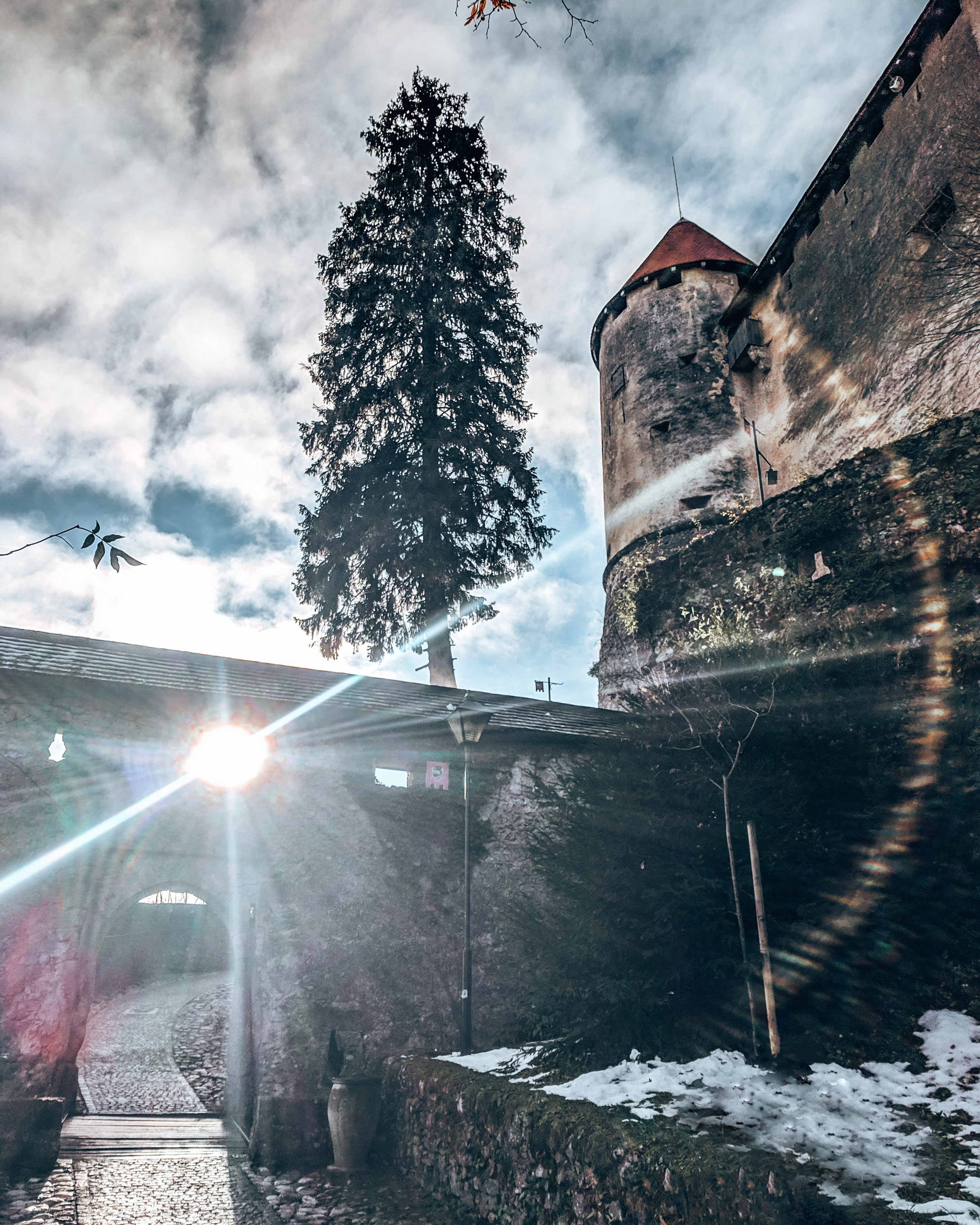 Sunflare through the gate at Bled Castle Slovenia