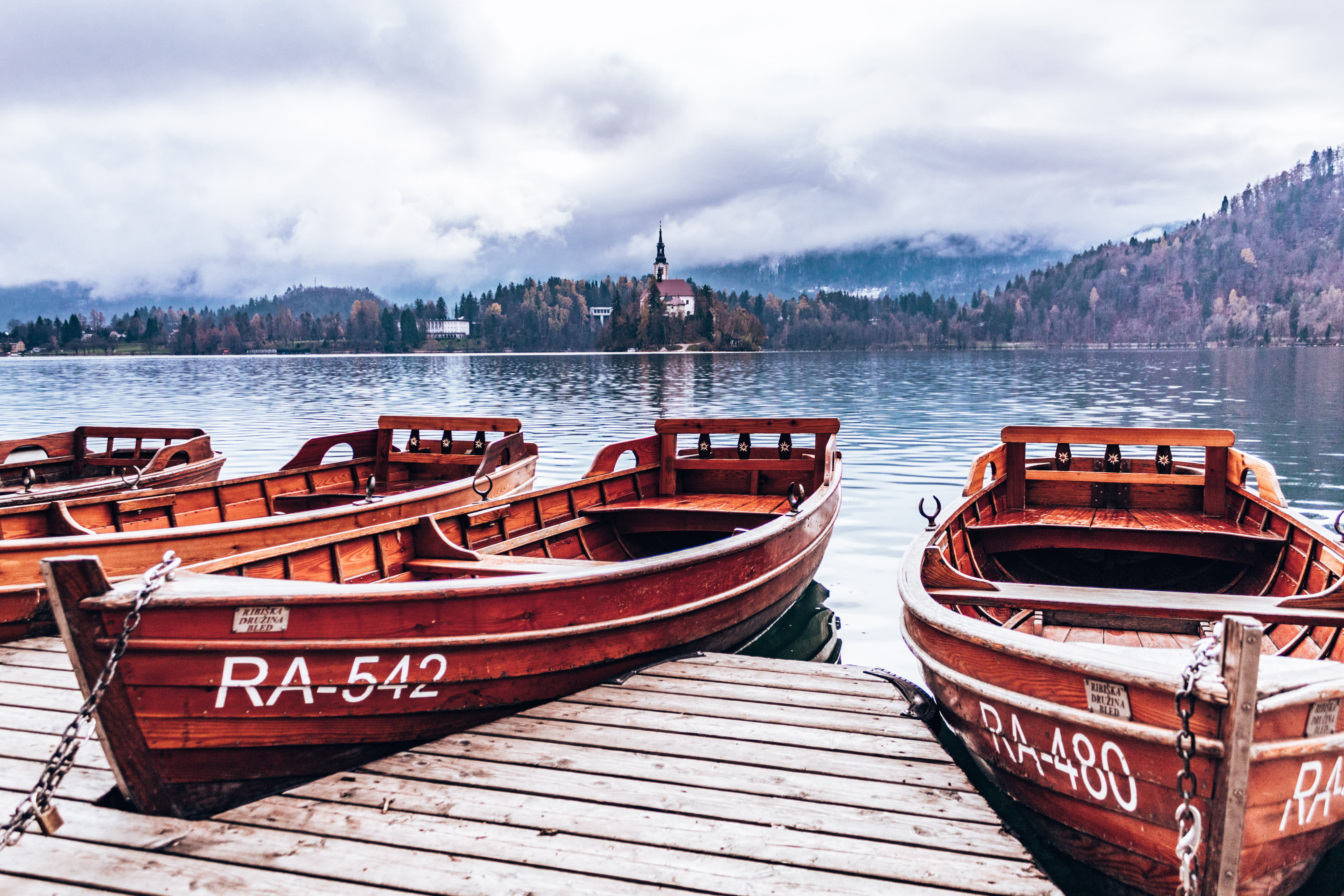 Wooden boats to bring you to the Pilgrimage Church of the Assumption of Maria at Lake Bled, Slovenia