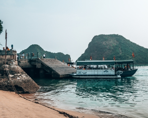 Getting to Ti Top beach by longboat in Halong Bay Vietnam