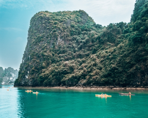 Tourists kayaking in Halong Bay Vietnam