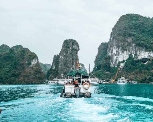 Sailing through Halong Bay Vietnam with many other boats