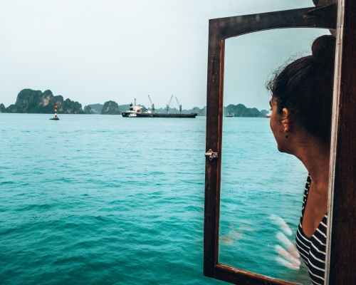 Carine gazing out the boat in Halong Bay Vietnam