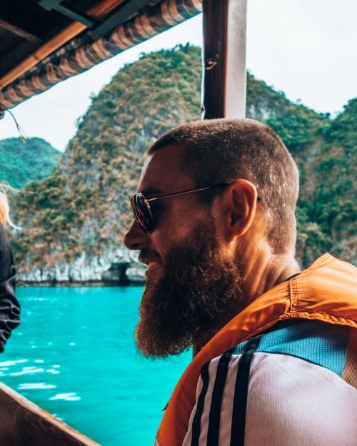 Derek riding a long boat in Halong Bay Vietnam